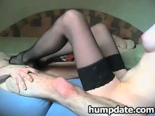 angel having on g-string and gives hubby footjob