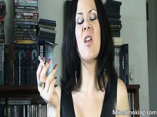 filthy brunette babe smokes a cigarette part1