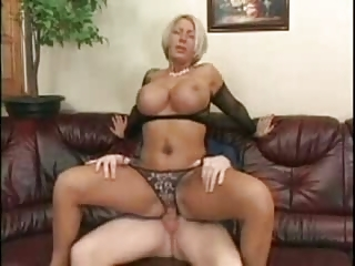 blonde woman with large chest into fishnets sm65