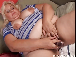 heavy big bossom woman lies back and strokes her