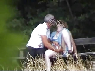woman into the garden having joy with guy