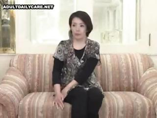 inexperienced japanese lady spreads wide and