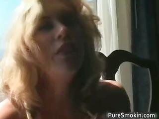 astonishing blonde older girl smokes cigarette