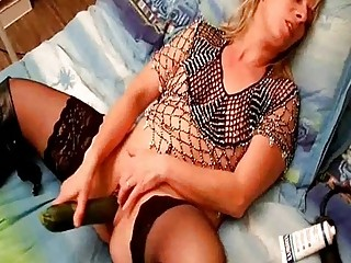my french woman sinks a zucchini into her pussy