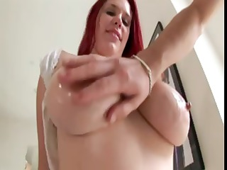 redheaded girl with huge knockers plays