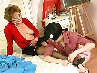 inexperienced lady kisses and licks older girl