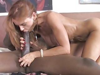 busty cougar takes a giant dark libido
