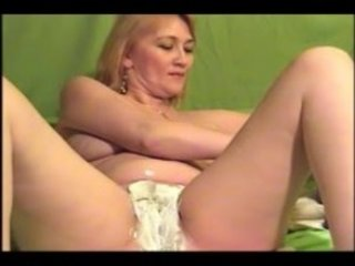 large breast mature babe shaves her vagina