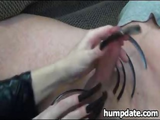 woman gives pleasing handjob with stretched