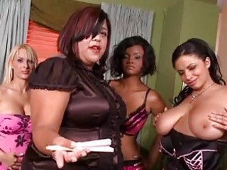 chubby milf with massive bossom putting on corset