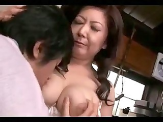 busty elderly woman obtaining her chest sucked