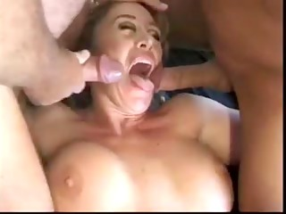 mature with large tits receives 2 dongs
