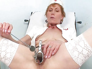 old lady self exam on gynochair with speculum