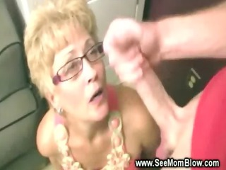 hungry older girl putting on glasses sucks cock
