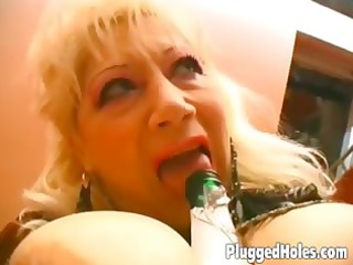 busty chick drives a bottle like insane