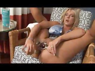 horny blonde mature angel uses a big plastic cock