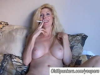sexy pale cougar babe enjoys a smoke break