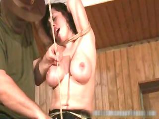 bondage sex scene with brunette woman