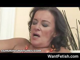 elderly brunette elderly loves to finger her