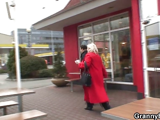 large grandma is picked up into cafe