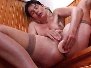 grown-up lady masturbates with her vibrators