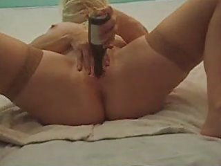 older lady dildoing with two bottles. selfmade.