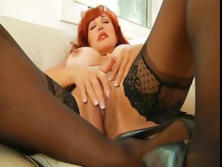 naughty grown-up redheaded babe wipes and fingers
