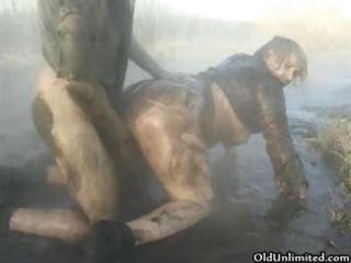 naughty elderly woman covered with mud obtains