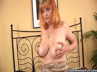redheaded old with giant bossom sucks strapon and