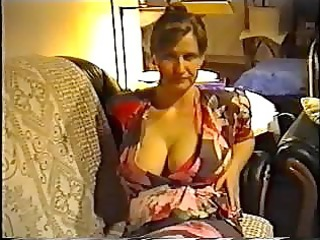 housewife flashing giant boobs in a g-string