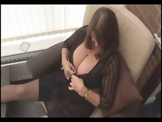 grownup brunette releases her giant chest for