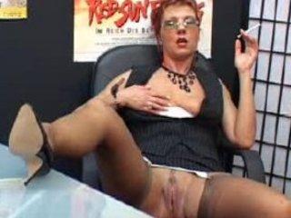gorgeous mature secretary smokes and fist vagina