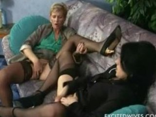 two housewifes sharing a more amateur boy