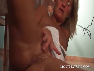 blonde grown-up seductress vibes her pussy