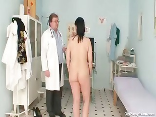 horny gyno nurse examines the hirsute vagina of