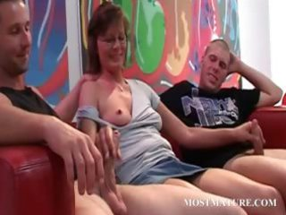 dirty lady blows two cocks in 3some