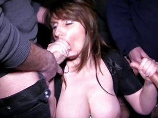 busty brunette milf acquires in a bukkake session