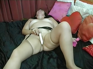 elderly puts on pantyhose after that fist and toys