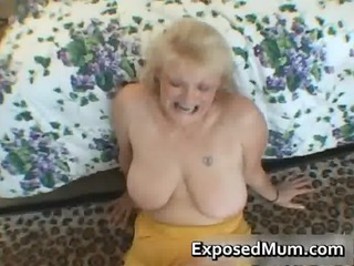 nasty lady shows her juggs and sucks penis