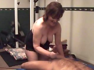 chubby elderly brunette woman gives a handjob and