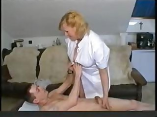 fat bleached old medic gives her patient head and