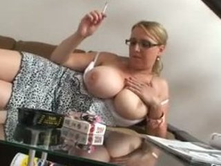 blonde woman with very big bossom smokes