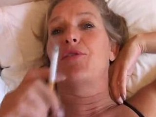 grown-up lady likes a smoke and a wank