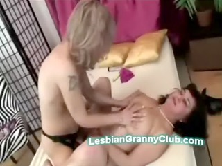 mature blonde babe with strapon fucks very