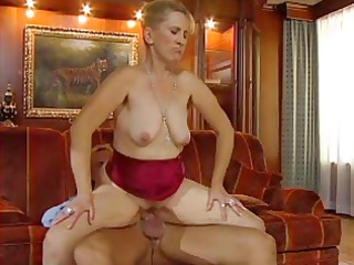 sexy woman n77 albino grown-up on a black couch