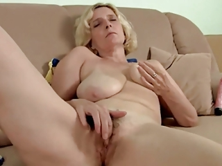 hairy older with saggy bossom pushing dildo by