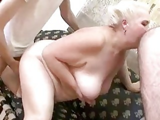 cougar servicing two inexperienced dicks