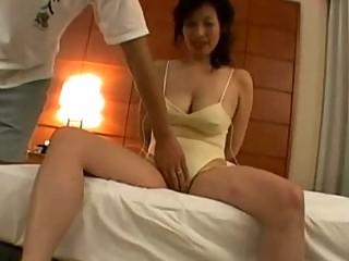 lady in bikini acquiring her breast and kitty