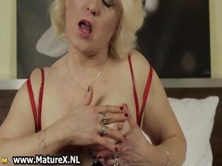 grown-up blond woman exposing part6
