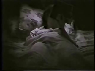 my mom on bed fisting reading a book. hidden cam